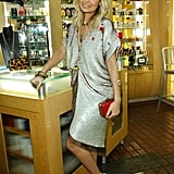 Nicole Richie takes the relaxed-glam approach in a loose-fitting, distressed, sparkly Halston frock.