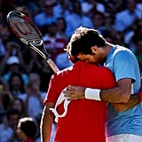 Roger Federer of Switzerland got a hug by Juan Martin Del Potro of Argentina after his semifinal tennis win.