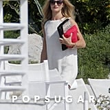 Rosie Huntington-Whiteley wore a white cover-up to the pool.