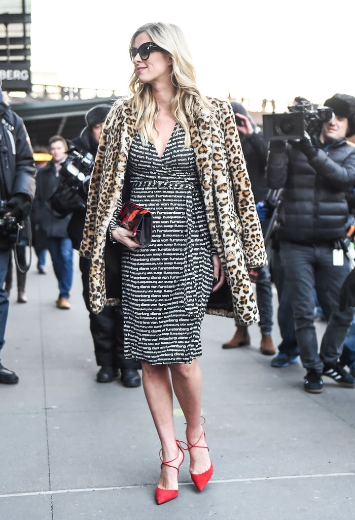 Nicky Hilton goes print on print in a furry leopard coat, a graphic DVF wrap dress, and red hot heels