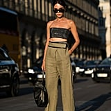 There's something daring but chic about a sequined bandeau and high-waisted pants.