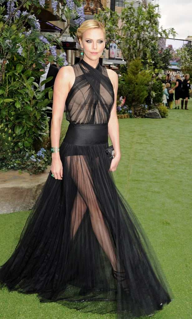 Charlize's dramatic arrival showed off her stems through the see-through sheer skirt.