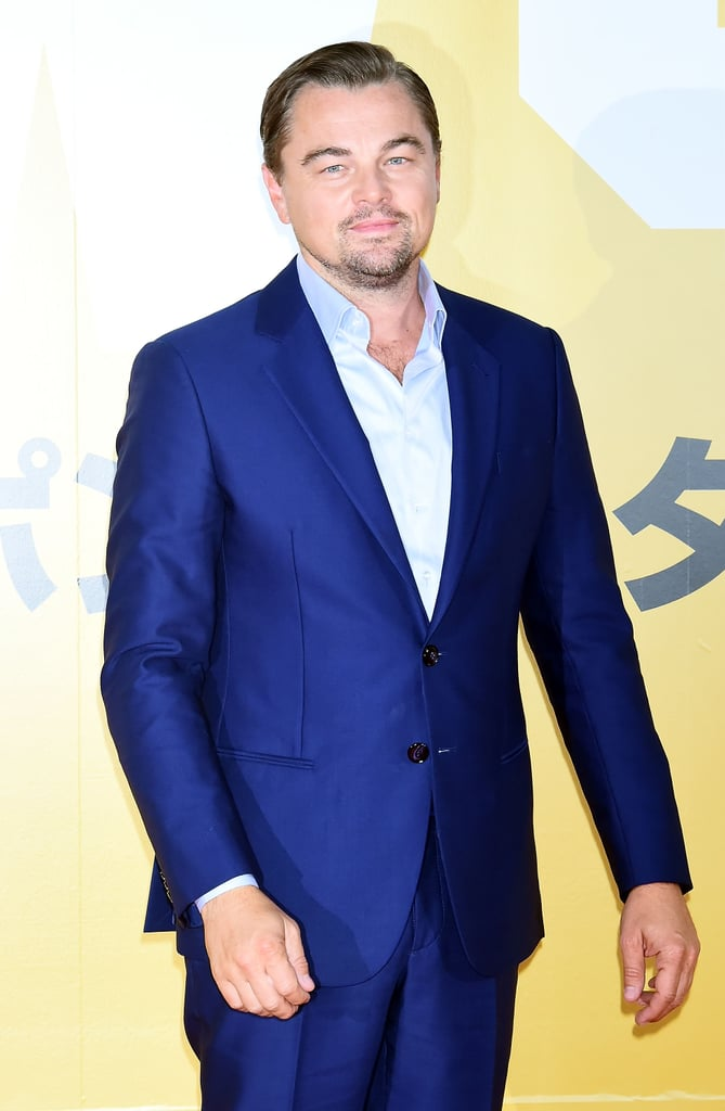 "Leonardo DiCaprio and director Quentin Tarantino continued the press tour for Once Upon a Time in Hollywood in Tokyo on Monday. After debuting the movie at the Cannes Film Festival in May and recently celebrating at the UK, Berlin, and Rome premieres with costars Brad Pitt and Margot Robbie, Leo put on quite the sexy show as he flashed his smile for the cameras and rocked the red carpet.  Once Upon a Time in Hollywood, which is out in theaters now, is described as ""a unique take on Manson Family Murders"" and ""takes place at the height of the counter-culture explosion, the hippie revolution, and the height of a new Hollywood."" While making their rounds to promote the film, the cast have also linked up for photocalls in London, as well as LA, where Brad was in a particularly photobombing mood. Check out photos from the glamorous press tour ahead!      Related:                                                                                                           If You Want to Get Technical, This Isn't Brad Pitt and Leonardo DiCaprio's First Movie Together"