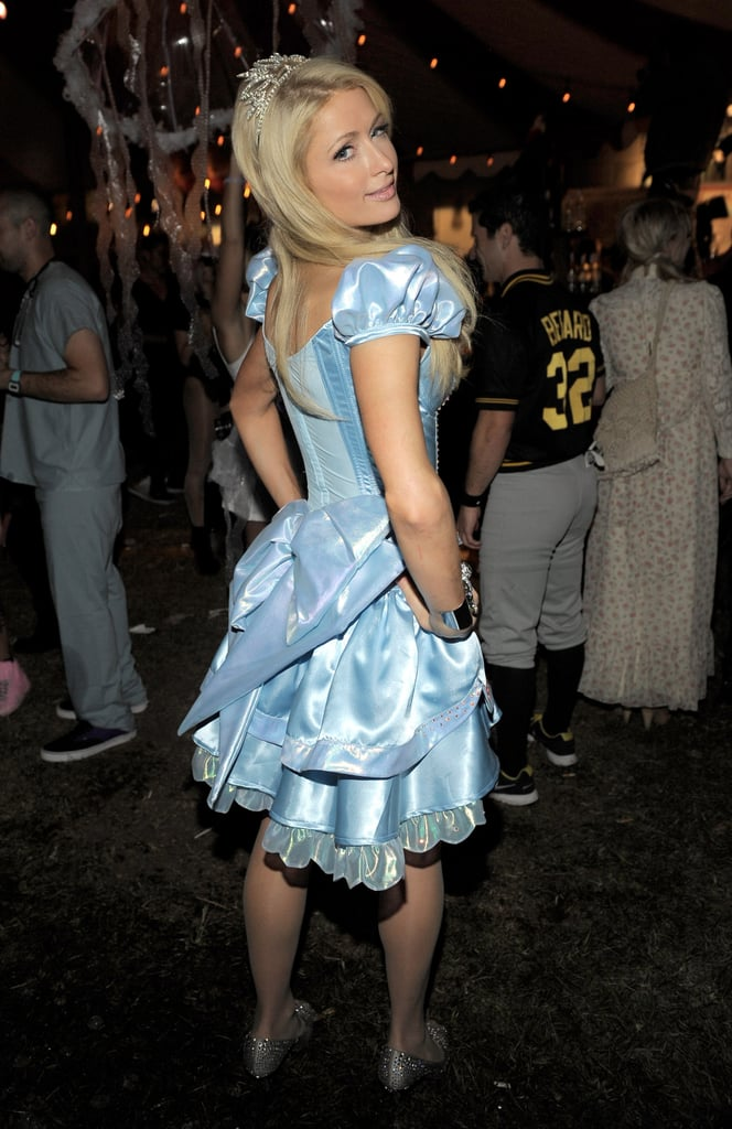 Paris Hilton showed off the back of her dress at a Halloween party.