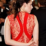Kristen Stewart flashed a gorgeous lace-inset back on her Reem Acra gown.