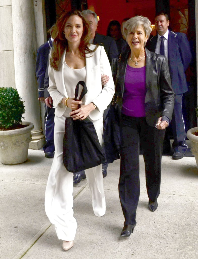 Jane Pitt held on to Angelina Jolie's arm.