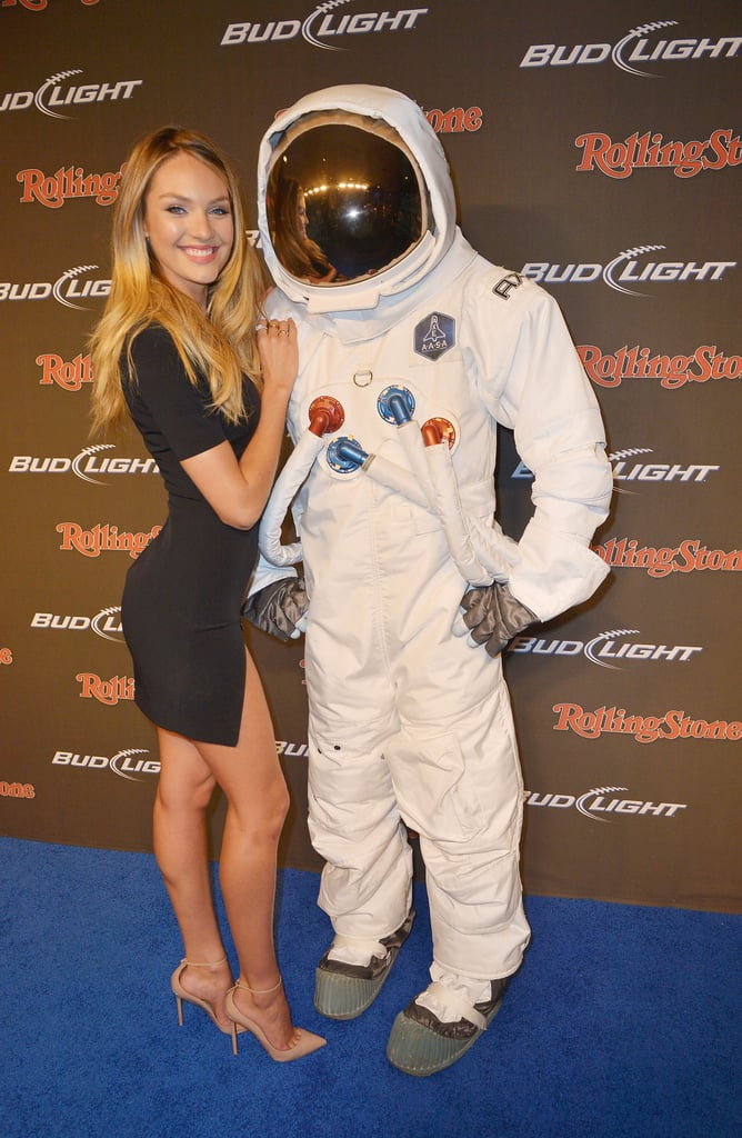 Candice Swanepoel cuddled up next to an astronaut before the Bud Light Hotel Super Bowl party Friday night.