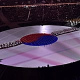 Drummers form the flag of South Korea.