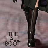 Why we love them: The first thing that comes to mind with the quintessential tall boot? It's a timeless classic, through and through. Tommy Hilfiger, Ralph Lauren, and Burberry remind us season after season of why we come back to this knee-high style, and whether you opt for an overtly equestrian-inspired iteration or a slick, back-zippered version, they are crisp, wear-with-everything shoes. How to wear them: If you're rocking flat, equestrian-style boots, then style them with our latest color fixation — oxblood red — perhaps with a fitted, ankle-cut trouser. If you're wearing a heeled tall boot, that added height and utilitarian accent will go perfectly with Fall's longer skirt selection.