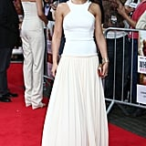 Cheryl accessorised with a champagne coloured satin clutch.