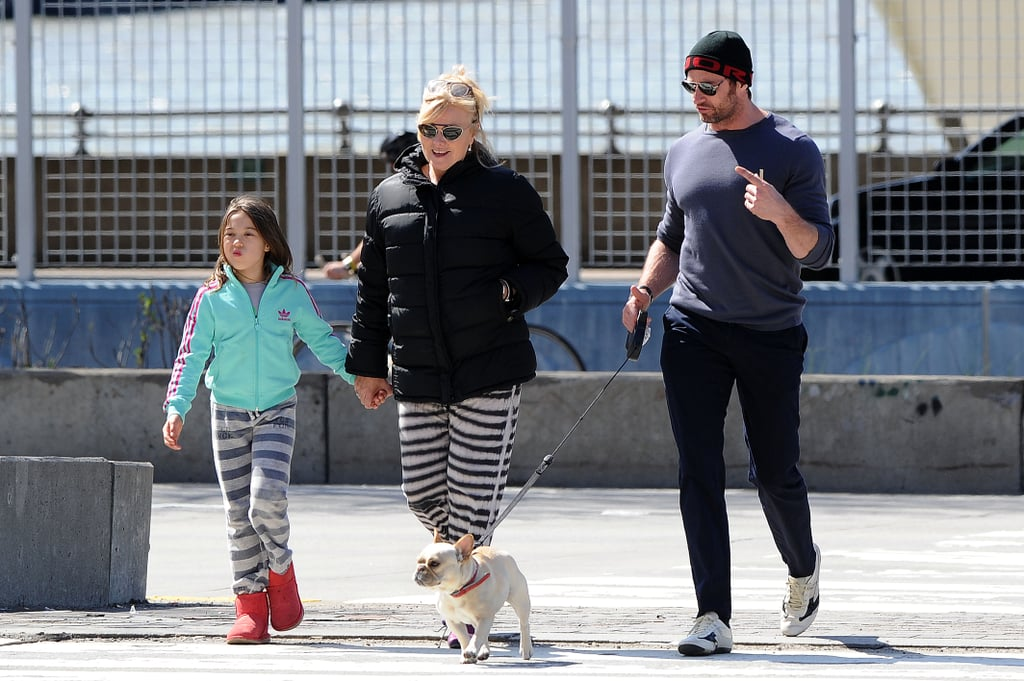 Hugh Jackman, his wife Deborra-lee Furness and their daughter Ava went for a stroll to Pier 90 in Manhattan yesterday. Deborra-lee held Ava's hand as Hugh took charge of their dog, Dali. The family outing came after a bizarre Saturday morning for Hugh, which involved a stalker incident while he was working out at the gym. According to the New York Post, an alleged female stalker stormed into the West Village gym and threw an electric razor at the star that was half-filled with pubic hair. She was then dragged away by staffers. Strange fan encounters aside, Hugh is shaping up for another busy year. The trailer for The Wolverine was released last month, and he will soon start work on the next film in the X-Men franchise, X-Men: Days of Future Past.