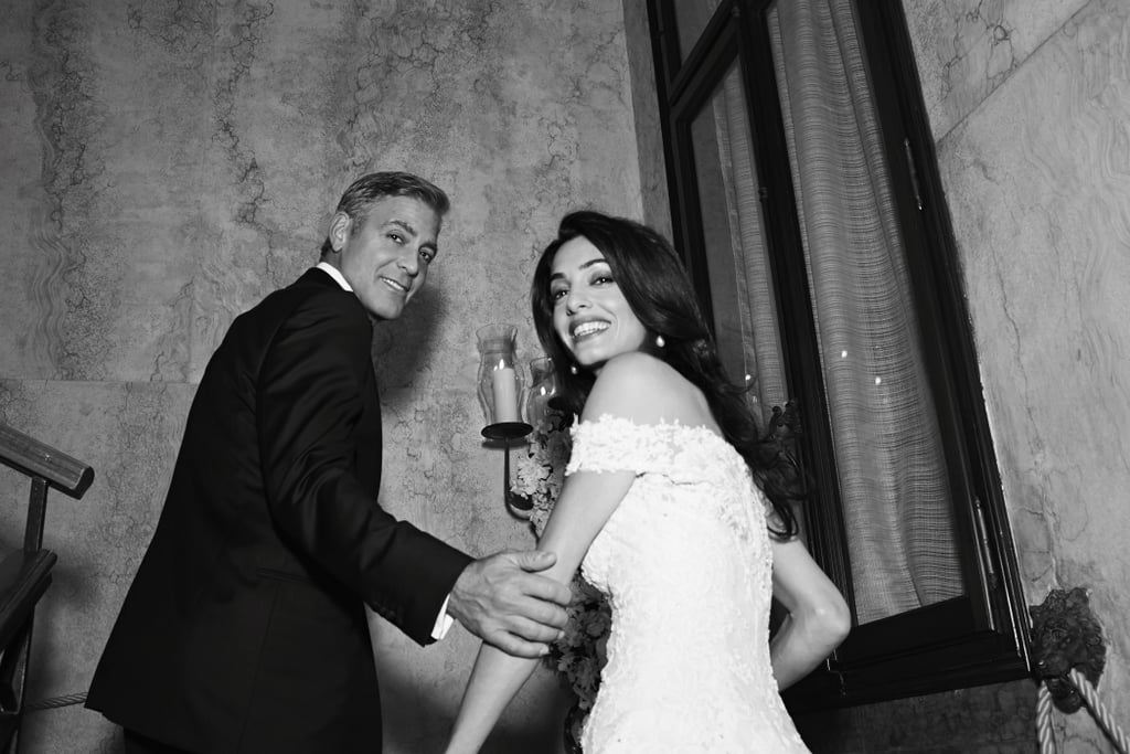 George Clooney and Amal Alamuddin tied the knot in Venice, Italy, in late September, and pictures of the pair's wedding show the couple celebrating and letting loose with their friends and family. Along with some stunning candids of the newlyweds, these never-before-seen snaps also include pictures of George goofing off with famous pals like John Krasinski and Emily Blunt, plus photos of other celebrity guests including Matt Damon and his wife Luciana, Anna Wintour, Bono, Cindy Crawford, and more. Their wedding, which was held at the Hotel Aman, made for a star-studded weekend, and following George and Amal's nuptials, they shared some official wedding pictures, including a gorgeous shot for the cover of People and beautiful portraits of Amal in her dress for Vogue. Take a look at all the fun photos from their wedding!