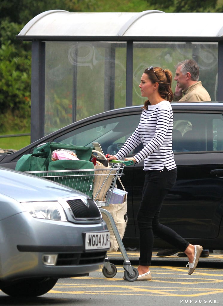 """It's the first time we've seen Kate Middleton since she left the hospital with Prince William and their son, Prince George, last month! Sporting a simple striped sweater and a ponytail —find out all about Kate's look —the new mom was spotted shopping at the local market on the island of Anglesey. Prince William has been based on the island since 2009, but the family is expected to leave next month. In a farewell speech given last week, he thanked the locals, saying, """"I know that I speak for Catherine when I say that I have never in my life known somewhere as beautiful and as welcoming as Anglesey."""" Last week, the royal couple shared Prince George's first official photo, a snapshot taken by Kate's dad, Michael Middleton, at her family's home in Bucklebury. The sweet picture featured the duke and duchess, their dog, Lupo, and the little prince, who's apparently a """"little bit of a rascal"""" according to Prince William. During his first interview as a father, Will joked, """"He either reminds me of my brother or me when I was younger, I'm not sure, but he's doing very well at the moment."""""""