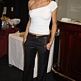On the casual side, but still capitalizing on a sexy feel, in a one-shouldered top at an event in '02.