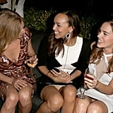 The girls of Revenge, Emily VanCamp, Ashley Madekwe, and Christa B. Allen, had a laugh together at GQ's afterparty.