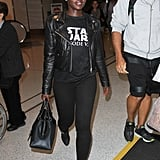 Lupita Nyong'o took a cue from the fashion crowd and added a leather jacket, instantly taking her casual all-black look to the next level.