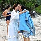Miranda Kerr wrapped her husband, Orlando Bloom, in a towel.