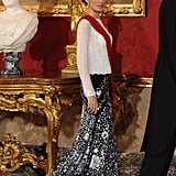 A Sparkly White Long-Sleeved Top and Floral Black and White Gown Skirt