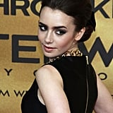 At the Berlin premiere of Mortal Instruments, Lily went with a retro chignon that was teased at the crown and embellished with a black bow. Her chic smoky eye makeup was a bit more modern.