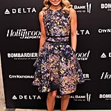 Kelly Ripa chose a colorful printed dress with cap-toe Proenza Schouler pumps at the Hollywood Reporter event in NYC. The allover print and ultraflattering silhouette would be a perfect fit for the bride-to-be or any shower guest.