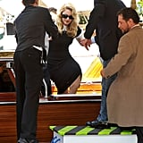 Madonna gets a hand leaving a Venice water taxi.