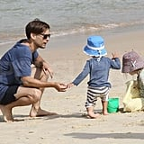 Tobey Maguire with Ruby and Otis on the beach.