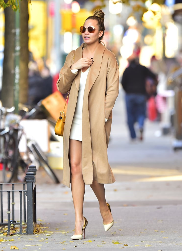 Ayr's robe coat kept Chrissy warm while shopping in SoHo in early December.