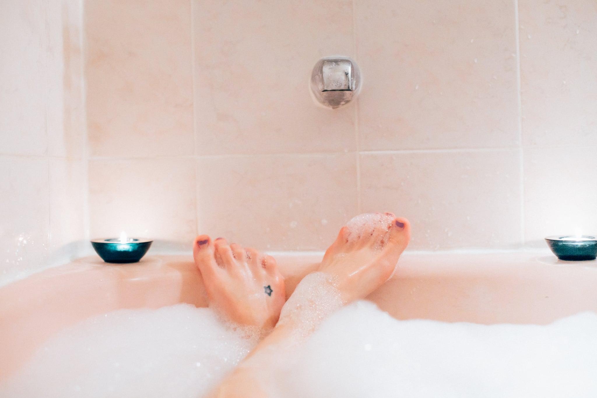 Woman's feet in bubble bath, bubble bath first person perspective, woman in bath tub, bubble bath, indulgence, bubbles, tub, bath first person perspective.