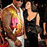 Lady Gaga chatted with Busta Rhymes on the VMAs red carpet.