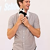 Andrew Garfield got cuddly with the World Wildlife Fund's panda mascot in the form of a tiny stuffed animal.
