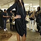 We love a draped LBD, just like the sexy effortless feel of this design.