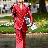 Leather Pants Outfit Idea: Red Leather Separates + Black Clutch