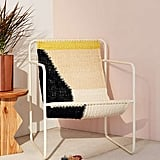 The hint of yellow on this Urban Outfitters Kimball Colorblock Macrame Sling Chair ($329) will add cheer to your home.
