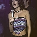 Donna, wearing a handkerchief top, shows off the corkscrew curls so popular in the mid-'90s.