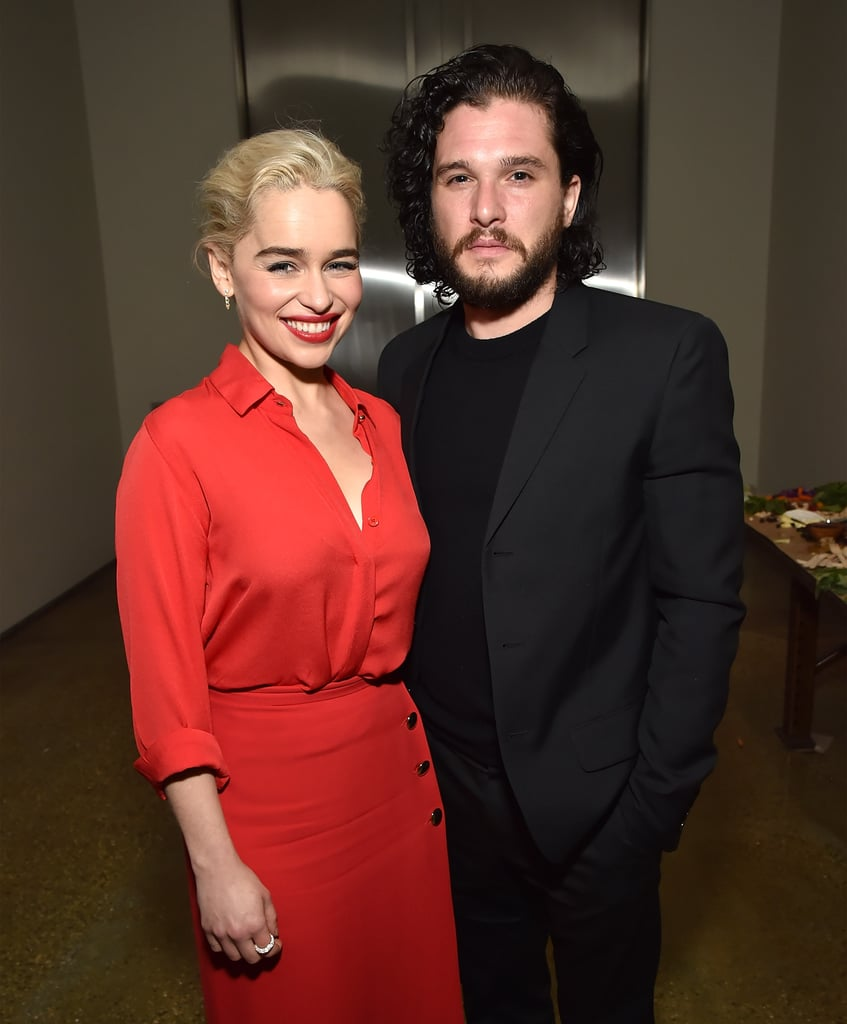 "Kit Harington paired up with his Game of Thrones costar Emilia Clarke at Sean Penn's annual Haiti Rising gala Saturday night. The onscreen love interests posed together for cute photos at the event, during which Brad Pitt bid a healthy $120,000 to watch an episode of the hit HBO series with Daenerys Targaryen herself; the actor dropped six figures in the hopes of winning the opportunity but was outbid by a fellow guest. Just one night before linking up with Emilia, Kit was thrown out of NYC haunt Barfly after drunkenly trying to play a round of pool with patrons. Apparently, Kit ""started banging on the table, grabbing at pool cues, and getting in people's faces."" TMZ also reported that the actor ""was asked to leave and did, but came back and finally had to be physically removed"" from the bar. Bummer! Keep reading to see more photos of Kit and Emilia together ahead of the Golden Globes."