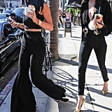 Kylie went with loose, wide-leg pants and a crop top, while Kendall rocked some black skinnies and a ribbed, low-cut Esosa shirt.