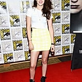 Kristen Stewart was the picture of Summer cool in a cropped Fluxus t-shirt, bright yellow BCBG skirt, and Barbara Bui kicks.
