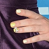 Zooey Deschanel's manicures are always the highlight of her red carpet looks, and this sunny yellow, striped nail design was the top pinned of them all.