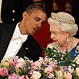 Sharing a secret with Her Majesty during a 2011 official visit to England.