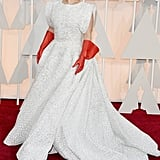 For the 2015 Oscars, Lady Gaga wore an Azzedine Alaïa dress with red leather gloves.
