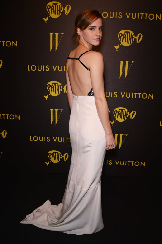 When she turned around, Emma revealed the sexy cutout back of her two-toned gown.