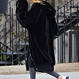 Gigi Brought the Same Black and White Color Palette to the Street With Two-Toned Trainers