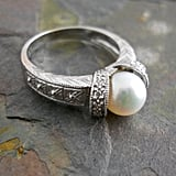 The etching on this silver band ($770) is delicate and holds five bead-set round diamonds.