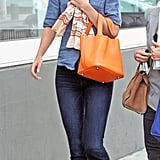 Katie Holmes went denim-on-denim — James Perse top and Paige jeans — while out for lunch with a pal in LA in 2011. A printed scarf, bold Hermès tote, and Isabel Marant ankle boots completed her Cali style.