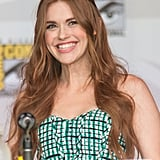Holland Roden was all smiles with her long red hair in easy waves at the Teen Wolf panel.