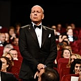 Bruce Willis stood at the opening ceremony of the 65th annual Cannes Film Festival.