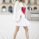 Take a tip from Olivia Palermo and throw a sophisticated blazer over your minidress and slip into smart loafers.