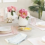Christine lists fresh flowers and neutral dinnerware that can be mixed and matched as her dinner party must haves.