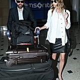 Kate Bosworth and Michael Polish had a full load at Sydney Airport.