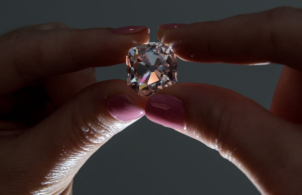 "A stunning pink diamond once belonging to French royalty for centuries will be auctioned by Christie's in Geneva. The brilliant-cut diamond with a slight pink sheen is approximately 19.07 carats.  Named ""Le Grand Mazarin,"" the jewel was first owned by Cardinal Mazarin, who served as France's chief minister in the mid-1600s. From that point on, the diamond embarked on quite the journey. It was gifted to the lavish King Louis XIV in 1661, before being stolen during the French Revolution and later making its way to Napoleon Bonaparte.  When it is auctioned on Nov. 14, it's estimated that the diamond will sell between $6 million to $9 million. The last time the diamond was auctioned was in 1887, and the last time it was even seen in public was in 1962! Ahead, see pictures of the rare and captivating jewel."